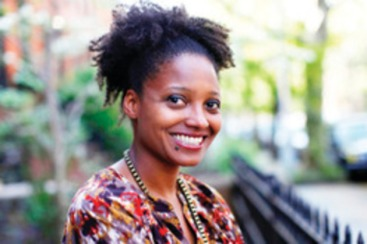 Tracy K. Smith, a creative writing professor at Princeton University, poses in her Brooklyn apartment after winning the Pulitzer Prize for poetry her poetry collection